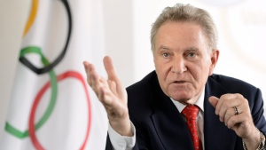 This is a June 3 , 2013, file photo showing Denis Oswald speaking during a press conference in Lausanne, Switzerland. Laurent Gillieron/Keystone via AP, File)