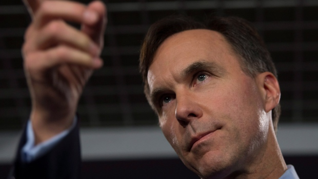Minister of Finance Bill Morneau speaks with the media before Question Period on Parliament Hill, in Ottawa on Thursday, October 19, 2017. (Adrian Wyld / THE CANADIAN PRESS)