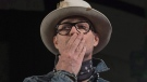 Gord Downie blows a kiss to the audience during a ceremony honouring the Canadian singer at the AFN Special Chiefs assembly in Gatineau, Que., Tuesday, December 6, 2016. THE CANADIAN PRESS/Adrian Wyld