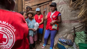 Red Cross volunteers talk to villagers about the plague outbreak, 30 miles west of Antananarivo, Madagascar, Monday, Oct. 16, 2017. (Alexander Joe/AP Photo)