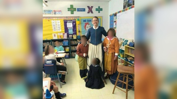 A photo from a historical lesson at a Massachusetts school has sparked outrage online. (Source: Facebook)
