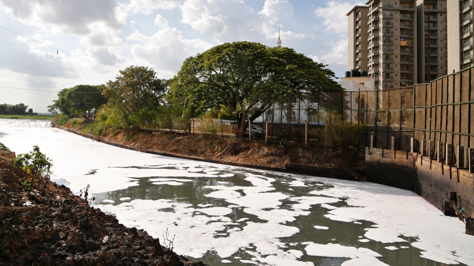 In this June 5, 2017, file photo, toxic froth from industrial pollution floats on Bellundur Lake on World Environment Day, in Bangalore, India. Environmental pollution - from filthy air to contaminated water - is killing more people every year than all war and violence in the world. (AP Photo/Aijaz Rahi, File)