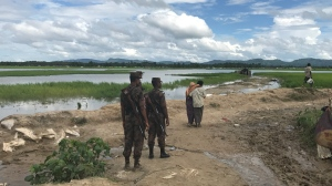 Bangladesh soldiers on the border with Myanmar look towards the no-man's land where thousands of Rohingya refugees are stranded. (Peter Akman / CTV News)