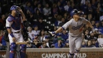 Los Angeles Dodgers' Enrique Hernandez hits a home run off Chicago Cubs relief pitcher Mike Montgomery during the ninth inning of Game 5 of baseball's National League Championship Series in Chicago on Thursday, Oct. 19, 2017. (AP / Matt Slocum)
