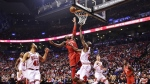Toronto Raptors forward CJ Miles drives to the basket as Chicago Bulls Quincy Pondexter defends during first half NBA basketball action in Toronto on Thursday, Oct. 19, 2017. (Frank Gunn / THE CANADIAN PRESS)