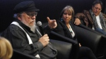 Author and film producer George R. R. Martin, left, speaks in Santa Fe, N.M., Thursday, Oct. 19, 2017. (AP / Morgan Lee)