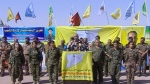 This frame grab from a video released Friday, Oct. 20, 2017 provided by Ronahi TV, a Kurdish TV channel media outlet, that is consistent with independent AP reporting, shows Talal Sillo, a spokesman and senior SDF commander speaks during a press conference held inside Raqqa city, Syria. (Ronahi TV, via AP)