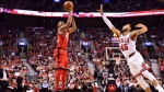 Toronto Raptors guard Norman Powell (24) shoots over Chicago Bulls guard Denzel Valentine (45) during first half NBA basketball action in Toronto on Thursday, October 19, 2017. THE CANADIAN PRESS/Frank Gunn