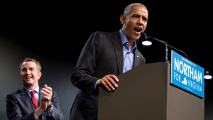 U.S. Former President Barack Obama, right, speaks as Virginia's Democratic gubernatorial candidate Lt. Gov. Ralph Northam listens during a rally in Richmond, Va., Oct. 19, 2017. (Steve Helber/AP)