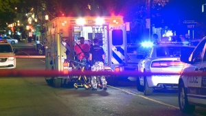 A robbery victim is loaded into an ambulance in Montreal (CTV Montreal/Cosmo Santamaria)