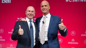 Bombardier President and CEO Alain Bellemare, left, and Airbus CEO Tom Enders gesture during a business meeting in Montreal, Friday, October 20, 2017. THE CANADIAN PRESS/Graham Hughes