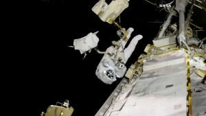 In this image from video made available by NASA, astronaut Joe Acaba performs a spacewalk outside the International Space Station on Friday, Oct. 20, 2017. (NASA via AP)