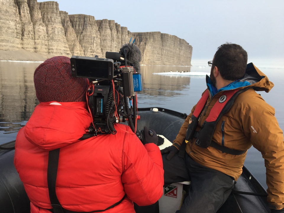 W5 Director of Photography Kirk Neff filming Arctic terrestrial bird and ecosystem research scientist Paul Smith (W5).