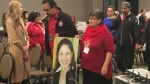 Bernice Catcheway, right, carries a picture of her daughter, Jennifer Catcheway, into a hearing of the national inquiry into missing and murdered women in Winnipeg on Friday Oct. 20, 2017. (Steve Lambert / THE CANADIAN PRESS)