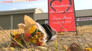 A makeshift memorial outside of the Fernie Memorial Arena in Fernie, B.C. following an October 17, 2017 ammonia leak that claimed three workers