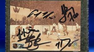 """This hockey card, which is signed by the members of The Tragically Hip and inspired their song """"Fifty Mission Cap"""", is being auctioned off until Oct. 26."""