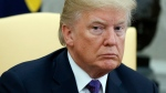 U.S. President Donald Trump listens during a meeting with Governor Ricardo Rossello of Puerto Rico in the Oval Office of the White House, Thursday, Oct. 19, 2017, in Washington. (AP Photo / Evan Vucci)