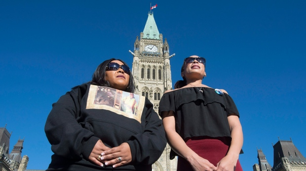 Diane Desmond, left, and Cassandra Desmond speak with the media outside Parliament in Ottawa, on Friday, October 20, 2017. (THE CANADIAN PRESS/Adrian Wyld)