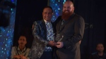 """CTV News videographer Peter Bremner, receives the """"Citizen of the Year Award"""" at the 2017 Diwali Gala Dinner in Surrey."""
