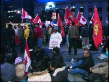 Tamil protesters converged on University Avenue overnight in preparation for a massive demonstration Monday morning.