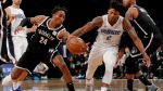 Brooklyn Nets forward Rondae Hollis-Jefferson (24) and Orlando Magic guard Elfrid Payton (2) chase the ball during the first quarter of an NBA basketball game, Friday, Oct. 20, 2017, in New York. (AP Photo/Julie Jacobson)