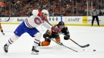 Montreal Canadiens left wing Max Pacioretty, left, shoots the puck as Anaheim Ducks defenseman Francois Beauchemin dives to try to stop it during the third period of an NHL hockey game, Friday, Oct. 20, 2017, in Anaheim, Calif. The Ducks won 6-2. (AP Photo/Mark J. Terrill)