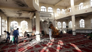 Afghans inspect inside a damaged mosque in Kabul, Afghanistan on Oct. 21, 2017, a day after a suicide attack. (AP / Rahmat Gul)
