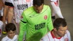 "In this Oct. 20, 2017 photo, Duesseldorf's goalie Raphael Wolfand and other players wear shirts that read ""Gegen Rechts"" (against right-wing) during the German second division soccer match between Fortuna Duesseldorf and Darmstadt 98, in Duesseldorf, Germany, declaring the club's opposition to far-right politics and thinking. (Bernd Thissen/dpa via AP)"
