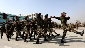 FILE - In this Sunday, Feb. 14, 2016 file photo, new members of the Afghanistan's National Army march during their graduation ceremony at the Afghan Military Academy in Kabul, Afghanistan. (AP Photo/Rahmat Gul)