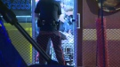 An EMS crew attends to a stabbing victim inside the Shawarma Palace early Saturday morning