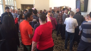 A long line up outside the convention room stretches through the hotel of people waiting to register and vote in the leadership race. (Beth Macdonell/CTV Winnipeg)