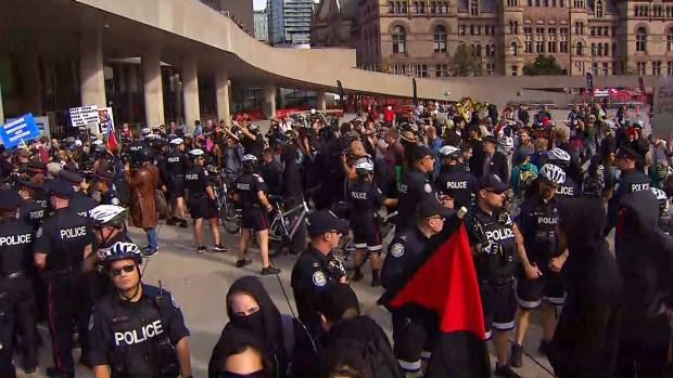 Police separate anti-Trudeau and anti-racist protesters at Nathan Phillips Square in Toronto on Oct. 21, 2017. (CP24)