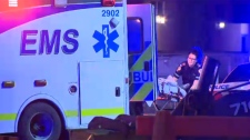 An EMS member loads a patient into an ambulance following Saturday morning's stabbing in a southeast restaurant