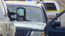 Bullet holes in the windshield of an SUV in Gleichen after RCMP fatally shot a man during a traffic stop