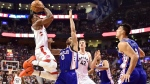 Toronto Raptors guard DeMar DeRozan (10) shoots over Philadelphia 76ers guard Jerryd Bayless (0) as Raptors centre Jakob Poeltl (42) and 76ers forward Dario Saric (9) look on during first half NBA basketball action in Toronto on Saturday, October 21, 2017. THE CANADIAN PRESS/Frank Gunn