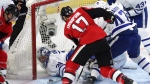 Ottawa Senators centre Nate Thompson (17) digs for a loose puck as he scores past Toronto Maple Leafs goalie Frederik Andersen (31) during first period NHL hockey action in Ottawa on Saturday, October 21, 2017. THE CANADIAN PRESS/Fred Chartrand