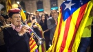 People gather in front of the Palau Generalitat in Barcelona, Spain awaiting for Catalan President Carles Puigdemont's speech Saturday, Oct. 21, 2017. Spain announced an unprecedented plan Saturday to sack Catalonia's separatist leaders, install its own people in their place and call a new local election, using previously untapped constitutional powers to take control of the prosperous region that is threatening to secede. (AP Photo/Santi Palacios)