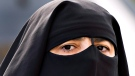 A woman wears a niqab as she walks in Montreal. (THE CANADIAN PRESS / Ryan Remiorz)