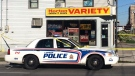 Police guard the scene of a brutal assault outside of the Horton Variety store in London, Ont. on Oct. 22, 2017. (Brent Lale/CTV)