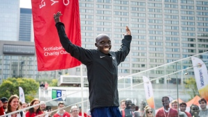 Kenyan runner Philemon Rono cheers on the crowd after winning the Toronto Marathon on Sunday, October 22, 2017. THE CANADIAN PRESS/Christopher Katsarov