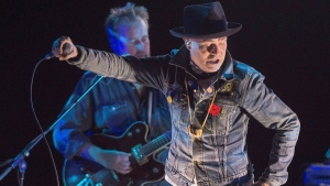 "Gord Downie performs his solo project ""Secret Path"" at the Rebecca Cohn Auditorium, in Halifax on Tuesday, Nov. 29, 2016. Downie, the poetic lead singer of the Tragically Hip whose determined fight with brain cancer inspired a nation, has died. He was 53. (Andrew Vaughan/THE CANADIAN PRESS)"