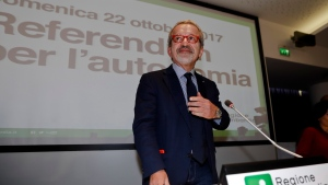 Lombardy Region President Roberto Maroni arrives for a press conference at the Lombardy Region headquarters, in Milan, Italy, Sunday, Oct. 22, 2017. (AP Photo/Luca Bruno)
