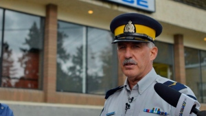 RCMP Cpl. Dan Moskaluk speaks to the media gathered at the Lake Country Police station in Winfield, B.C. on Friday, Oct. 14, 2016. THE CANADIAN PRESS/Desmond Murray