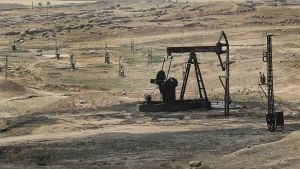 An oil field controlled by the Kurdish-led Syrian Democratic Forces (SDF), in Rmeilan, Hassakeh province, northeast Syria is seen on July 30, 2017. (AP / Hussein Malla)