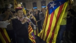 People gather in front of the Palau Generalitat in Barcelona, Spain awaiting for Catalan President Carles Puigdemont's speech on Saturday, Oct. 21, 2017. (AP / Santi Palacios)