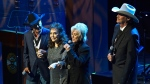 George Strait, left, Loretta Lynn, second from left, and Connie Smith join Alan Jackson, right, in singing 'Will the Circle Be Unbroken' during Jackson's induction into the Country Music Hall of Fame on Sunday, Oct. 22, 2017, in Nashville, Tenn. (Andrew Nelles/The Tennessean via AP)