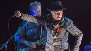 """Gord Downie performs his solo project """"Secret Path"""" at the Rebecca Cohn Auditorium, in Halifax on Tuesday, Nov. 29, 2016. Downie, the poetic lead singer of the Tragically Hip whose determined fight with brain cancer inspired a nation, has died. He was 53. THE CANADIAN PRESS/Andrew Vaughan"""