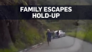 Caught on camera: Family flees hold-up