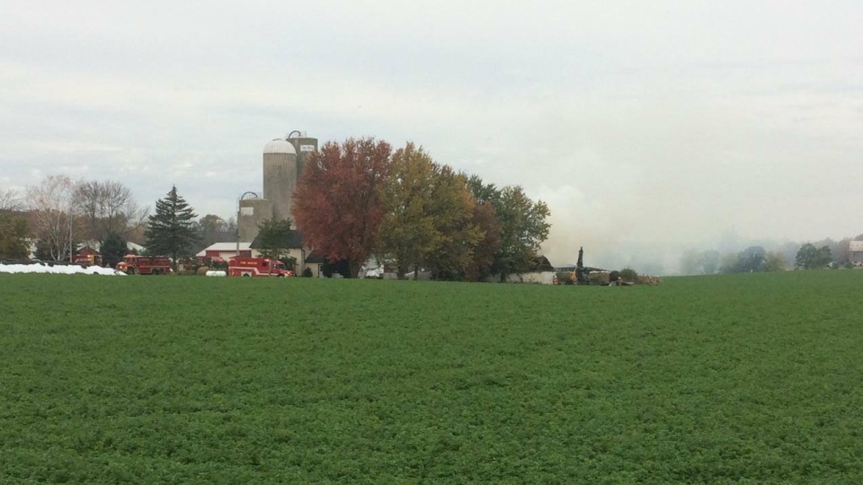 Firefighters are battling a barn fire north of Woodstock, Ont., on Monday, Oct. 23, 2017. (Sean Irvine / CTV London)