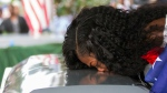 """In this Saturday, Oct. 21, 2017, file photo, Myeshia Johnson kisses the casket of her husband, Sgt. La David Johnson during his burial service at Fred Hunter's Hollywood Memorial Gardens in Hollywood, Fla. Myeshia Johnson told ABC's 'Good Morning America' on Monday, Oct. 23, 2017, that she has nothing to say to the president, adding that his phone call to her made """"me cry even worse."""" (Matias J. Ocner/Miami Herald via AP, File)"""